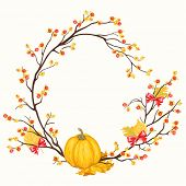 Wreath with pumpkin, leaves, bows and oriental bittersweets.