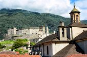 BELLINZONA, SWITZERLAND - July 4, 2014: The Collegiate Church and Castelgrande in Bellinzona, Switzerland. Two of Bellinzonas most famous landmarks and UNESCO World Heritage Site.