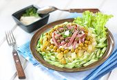Polish Salad With Potatoes, Ham, Cucumber, Green Peas, Capers And Mayonnaise