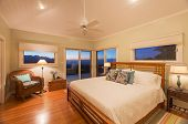 Cozy spacious bedroom in beautiful home at sunset