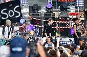 NEW YORK-JUL 22: (L-R) Michael Clifford, Ashton Irwin, Luke Hemmings and Calum Hood of 5 Seconds Of Summer perform on NBC's 'Today Show' at Rockefeller Plaza on July 22, 2014 in New York City.
