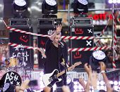 NEW YORK-JUL 22: Recording artist Luke Hemmings of 5 Seconds Of Summer performs in concert on NBC's 'Today Show' at Rockefeller Plaza on July 22, 2014 in New York City.