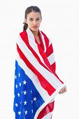 Pretty brunette wearing the american flag on white background