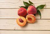 Freshly picked organic peaches on yellow