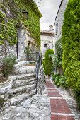 Winding narrow stone streets in Eze near Nice, France.