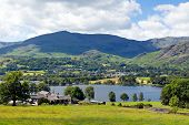 Coniston Water and mountains Lake District England uk blue sky white clouds