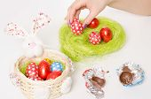 Decorating Easter Bunny Basket With Chocolate Eggs
