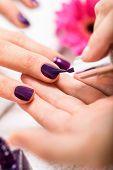 Woman Having A Nail Manicure In A Beauty Salon