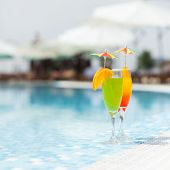 Cocktails at the edge of the swimming pool