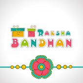 Beautiful rakhi with colorful gift boxes on grey background for Raksha Bandhan celebrations.