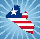 Liberia map flag on blue sunburst illustration
