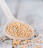 Mustard Seeds On A Cooking Spoon