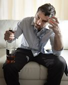 Alcoholic Drunk Businessman Wasted And Whiskey Bottle In Alcoholism