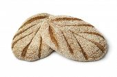 Fresh baked Moroccan semolina bread on white background