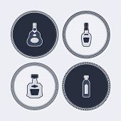 stock photo of vodka  - 4 alcohol bottles icons shows off different bottles shapes like a vodka and a beer. Pictured here from left to right - 