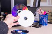 Hand Holding White Blank Cd Dvd Disk
