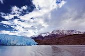 Chilean Patagonia. National Park Torres del Paine. Lake and Glacier Grey. The clouds covered the sun