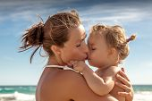 traveling family  female woman hugs baby on vacations