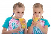 twin sisters love to drink orange juice.