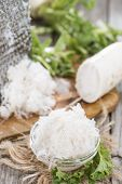 picture of grated radish  - Portion of grated Horseradish on wooden background - JPG
