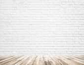 Background of age grungy texture white brick and stone wall with light wooden floor with whiteboard