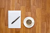 Blank Notepad With Office Supplies And Cup Of Coffee On Wooden Table