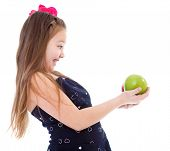 Young girl with green apple.