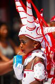 Rotterdam, the Netherlands - July 19, 2014, Young carnival dancer in the parade at the Caribbean Carnival in Rotterdam on July 19 in Rotterdam, The Netherlands