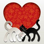 Valentine card with two paper white and black cats in love against a red heart with floral backgroun