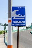 MOLLENDO, PERU, MAY 20, 2014 - Sign showing evacuation route in case of tsunami