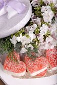 Sweets with flowers on wooden background