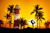 stock photo of natarajasana  - Man doing Yoga dancer pose in silhouette near lighthouse at sunset sky in Kovalam Kerala India - JPG