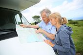 picture of camper  - Senior people reading road map by camper - JPG