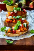 Bruschetta with roasted pumpkin, red pepper,pesto and cheese