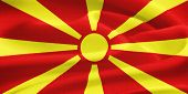 stock photo of former yugoslavia  - flag of Macedonia waving in the wind - JPG