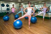 Fitness class using exercise balls in studio at the gym
