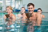 pic of day care center  - Fitness class using underwater exercise bikes in swimming pool at the leisure centre - JPG