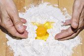 Hands Making Dough With Flour And Egg