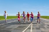 Group Of Children Running On The Treadmill