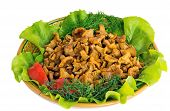 Fried Mushrooms Of Chanterelle On A Dish Together With Lettuce Leaves And Vegetables.
