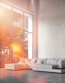 Modern living room interior with bright sun flare through a floor-to-ceiling glass wall bathing a co