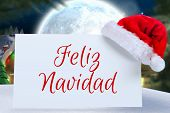 stock photo of quaint  - Feliz navidad against quaint town with bright moon - JPG