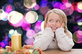 Cute little girl against twinkling yellow and purple lights