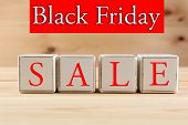 Black Friday Sale advertising on wooden background