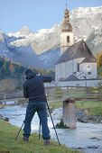Photgrapher Is Taking Pictures Of A Church In The Mountain