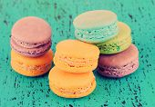 Macaroons on wooden surface close-up