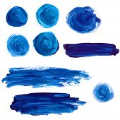 Set of blue acrylic paint stains and strokes. Artistic design elements.