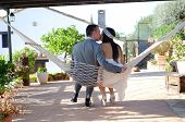 Groom Bride Kissing Sitting In A Hammock Rope