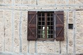 stock photo of quaint  - Quaint details on a building in a small French town - JPG