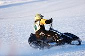 NOVOSIBIRSK, RUSSIA - DECEMBER 20, 2014: Roman Kholodov of Izhevsk during the semi-final individual rides of Russian Ice Speedway Championship. The sports returns to the sport arenas after a decline